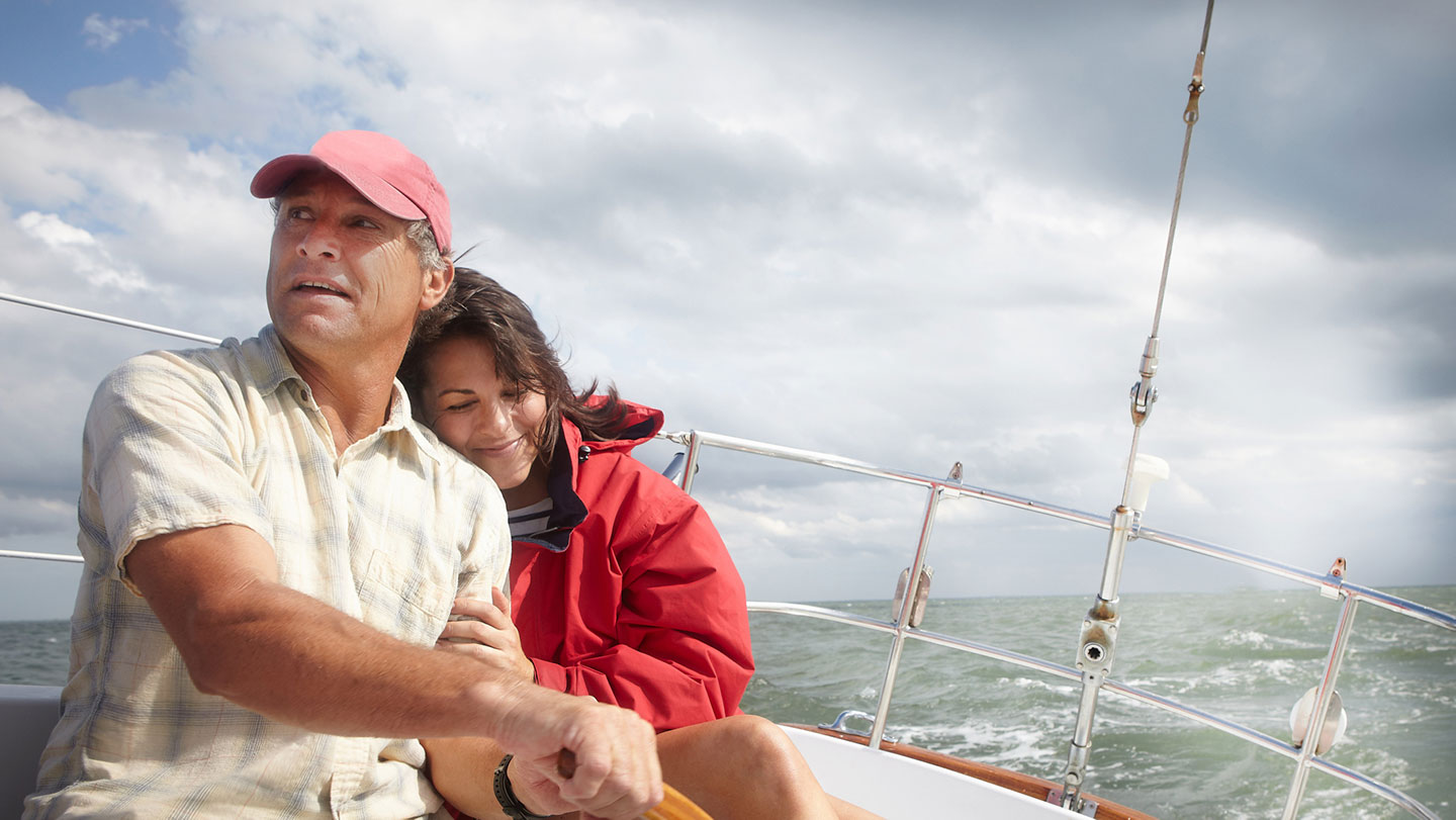 Retired couple on a sailboat