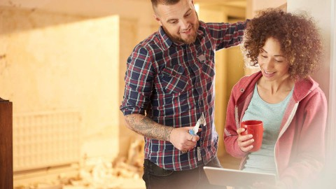 Couple reviewing remodeling plans